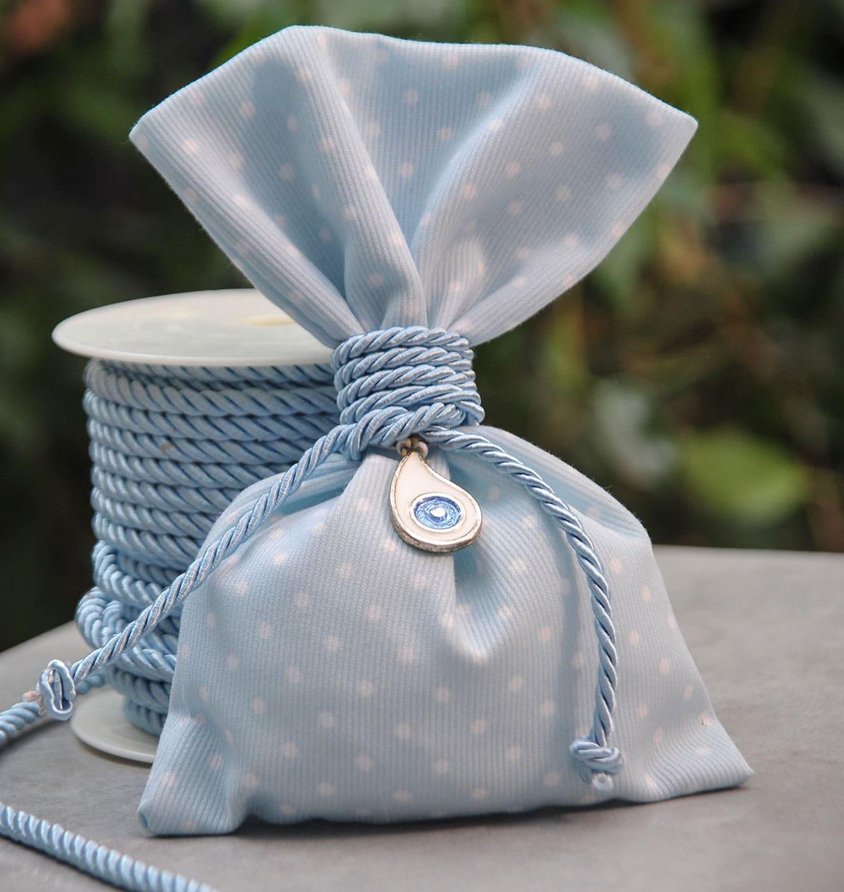 Μπομπονιέρα γαλάζιο με λευκό πουά πουγκί με αντικείμενο ματάκι